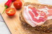 Tomato, toasts, meat on wooden table — Stock Photo