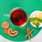 Cup of tea with mint, cinnamon and lemon — Stock Photo #77257934