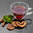 Cup of tea with mint, cinnamon and cookies — Stock Photo #77257936