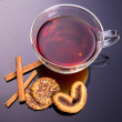 Cup of tea with mint, cinnamon and cookies — Stock Photo #77257942