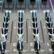 Detail of a music mixer in studio — Stock Photo #77633828
