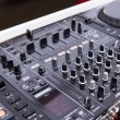 Detail of a music mixer in studio — Stock Photo #77633942