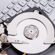 Hard disk HDD over laptop keyboard — Stock Photo #77643286