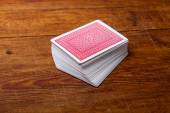 Deck of cards on wooden table — Stock Photo
