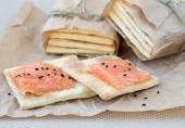 Cracker with a salmon — Stock Photo