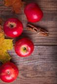 Red apples and yellow leaves — Stock Photo