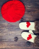 Cute knitted mittens with red hearts — Stock Photo