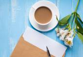 Cup of coffee with milk, blank paper in the envelope, pen and al — Stock Photo