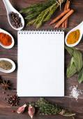 Fresh herbs, different spices notebook on the table — Stock Photo