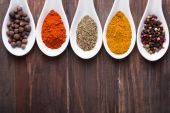 Different spices in a white spoons — Stock Photo