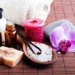 Spa still life with vanilla pods, hand made soap and aroma oils — Foto de Stock   #64719163