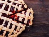 Homemade pie with jam on the wooden table — Stock Photo