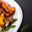 Постер, плакат: Delicious salad with grilled peaches and prosciutto