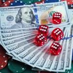 Casino dice in Dollars bill background — Stock Photo #57250073