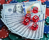 Casino dice in Dollars bill background — Stock Photo