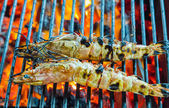 Shrimp, prawn seafood in BBQ Flames — Stock Photo