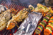Grill cooking seafood top view — Stock Photo