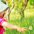 Baby and dandelion — Stock Photo #55352123