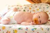 Newborn on the cover dresser — Stock Photo