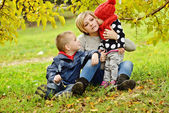 Family on fall meadow — Stock Photo