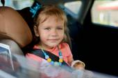 Child in car — Stock Photo