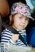 Funny girl in car — Stock Photo