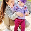 Mother helping her baby to walk — Stock Photo #73486733