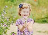 Cute girl with flower — Stock Photo