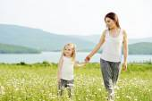 Mother and daughter in field — Stock Photo