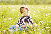Girl in field in backlit — Stock Photo
