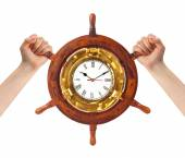 Hands and helm clock - time management — 图库照片