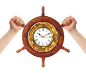 Hands and helm clock - time management — Photo
