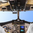 Pilots in the plane cockpit and sky — Stock Photo