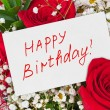 Roses bouquet and card Happy Birthday — Stock Photo #51951207
