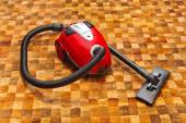 Vacuum cleaner on carpet — Stock Photo