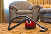 Vacuum cleaner in room — Stock Photo