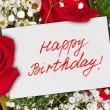 Roses bouquet and card Happy Birthday — Stock Photo #53430359