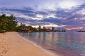 Cafe on Seychelles tropical beach at sunset — Stock Photo