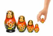 Hand and russian toy matrioska — Stockfoto