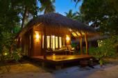 Beach bungalow at sunset - Maldives — Stock Photo