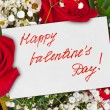 Roses bouquet and Valentines day card — Stock Photo #56114375