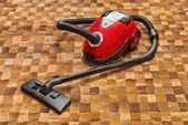 Vacuum cleaner on carpet — Stock Photo