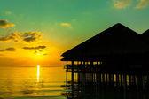 Water cafe at sunset - Maldives — Stock Photo