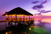 Water cafe at sunset - Maldives — Stock Photo