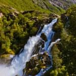 Waterfall near Briksdal glacier - Norway — Stock Photo #57431823