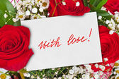 Roses bouquet and greeting card — Stock Photo