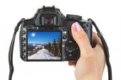 Camera in hand and winter Austria view — Stock Photo