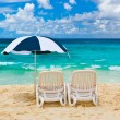 Chairs and umbrella at tropical beach — Stock Photo #59940097