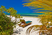 Loungers on Maldives beach — Stock Photo