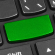 Computer notebook keyboard with blank green key — Stock Photo #64660635